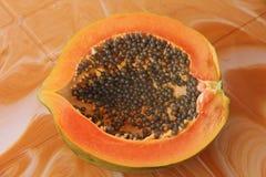 Orange open papaya with black seeds. Papaya close-up. Fruits of. Asia, healthy food, natural fruits Royalty Free Stock Image