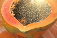 Orange open papaya with black seeds. Papaya close-up. Fruits of. Asia, healthy food, natural fruits Stock Photo