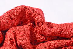 Orange openwork knitted closeup Royalty Free Stock Photography