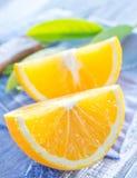 Orange. Oprange and leaf on a table Stock Photo