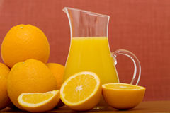 Orange and orange juice Stock Photos