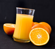 Orange and orange juice Royalty Free Stock Image