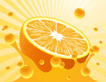 Orange_in_the_orange_juice Stock Image