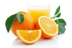 Orange with orange juice and the cut slices Royalty Free Stock Photography