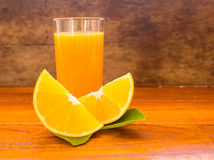 Orange ,orange juice, orange and orange juice on wood backgruond Royalty Free Stock Photography