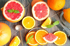 Orange and orange slices and segments, mint leaves and knife Royalty Free Stock Photo