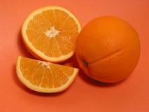 Orange oranges 1. Fresh oranges on orange background royalty free stock photography