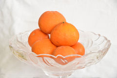 Orange. S on a fruit bowl glass Stock Images