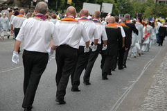 Orange order march. A line of men marching on July 12th, in an orange order march in Northern Ireland, commerating 1690 and the Battle of the Boyne where King Stock Photos