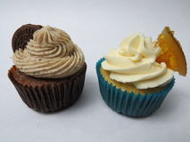 Orange and Oreo Cupcake's. Oreo and orange cupcakes with cream on white background Stock Images