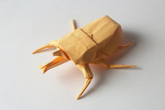 Orange origami bug Stock Images