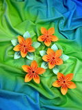 Orange origami flowers Stock Images