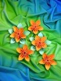 Orange origami flowers Stock Images