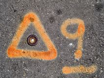 Orange paint marks on asphalt Royalty Free Stock Photos