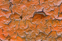 Orange paint peeled off of a wall Stock Photography