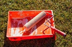 Orange Paint Roller Stock Photo