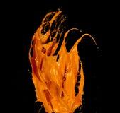 Orange paint splash on black background. Orange paint splash isolated on black background royalty free stock photos