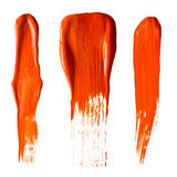 Orange paint strokes Stock Photos