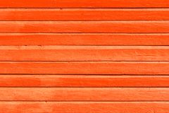 Orange painted wooden background, texture or wall royalty free stock photo