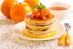 Orange pancakes with candied zest. On top Royalty Free Stock Photo