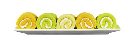 Orange, Pandan and Vanilla Swiss Rolls isolated on white background Royalty Free Stock Photos
