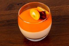 Orange Panna cotta. With cumquat stock photos