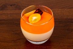 Orange Panna cotta. With cumquat royalty free stock photo