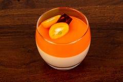 Orange Panna cotta. With cumquat royalty free stock image