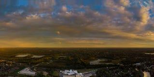 Orange panorama sky magic sunset cloud over city scape Royalty Free Stock Photo