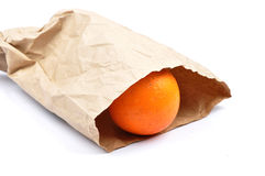Orange in paper bag Royalty Free Stock Images