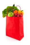 Orange paper bag with healthy food Royalty Free Stock Photo