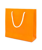 Orange paper bag isolated on white background. Stock Images