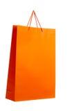 Orange paper bag on white. Royalty Free Stock Photo