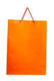 Orange paper bag on white. Royalty Free Stock Photos