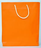 Orange paper bag and white nylon handle Stock Photos