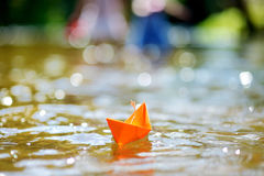 Orange paper boat with a white flag Royalty Free Stock Photography