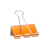 Orange paper clip isolated on white Royalty Free Stock Images
