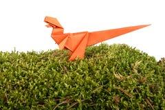 Orange paper dinosaur Stock Photo