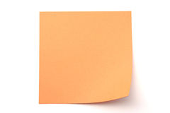 Orange paper stick note on white background. Orange paper stick note on a white background Royalty Free Stock Images