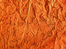 Orange paper texture. Rough orange paper texture suitable as background Stock Photos