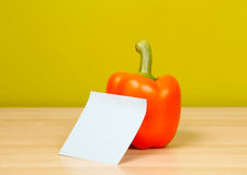 Orange paprika with sticky note Royalty Free Stock Photo
