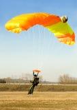 Orange parachute landind. An orange parachute is landind Royalty Free Stock Photos