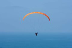 Orange paraglider at Torrey Pines Gliderport in La Jolla Stock Photos