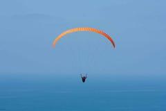 Orange paraglider at Torrey Pines Gliderport in La Jolla Stock Photos