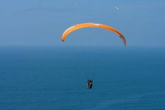 Orange paraglider at Torrey Pines Gliderport in La Jolla Stock Photo