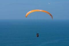 Orange paraglider at Torrey Pines Gliderport in La Jolla Stock Photo