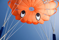 Orange parasail against blue sky Royalty Free Stock Images