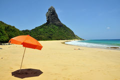 Orange parasol. Empty beach with a orange parasol Royalty Free Stock Photography