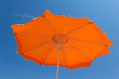 Orange parasol against a blue sky. Inside of an orange parasol against a blue sky Stock Photography
