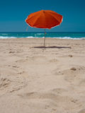 Orange parasol on the beach Royalty Free Stock Images
